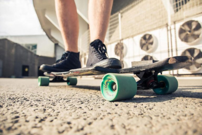 how to put trucks on a longboard