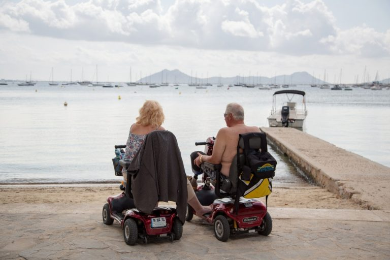 power wheelchair vs scooter