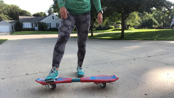 Place your non-dominant foot on the nose of the board